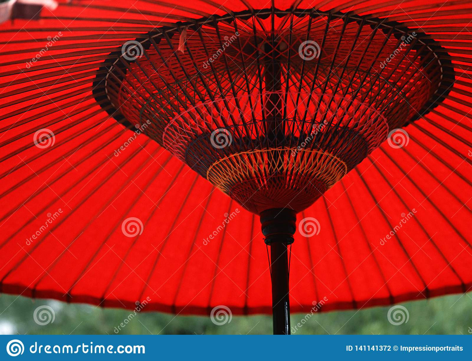 A Japanese red and black wooden umbrella background