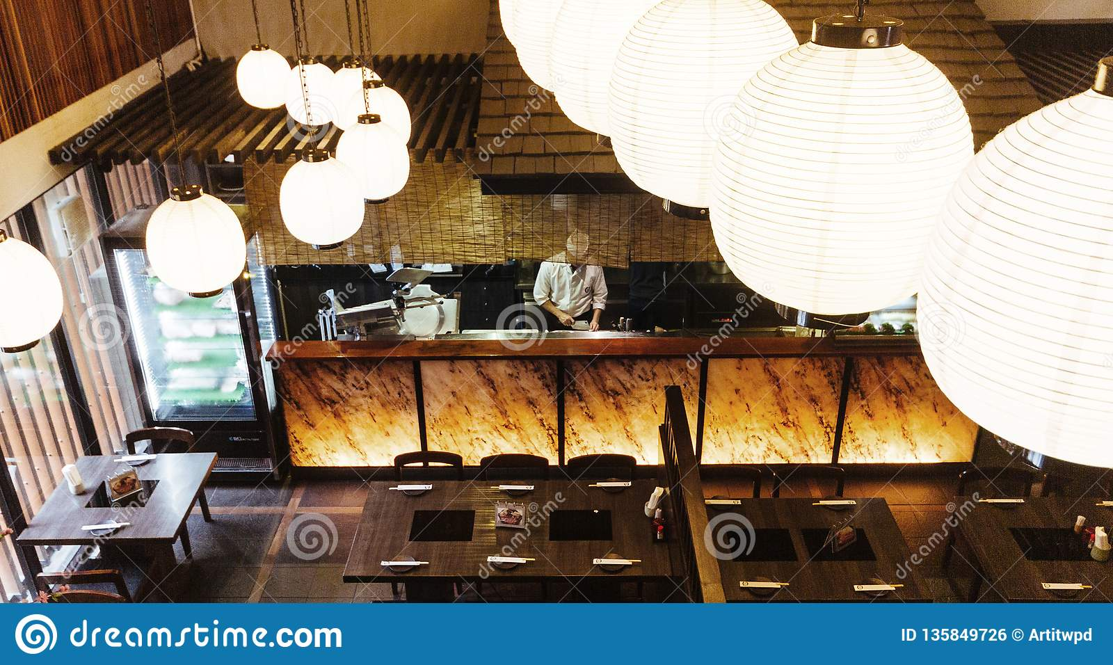 Japanese Restaurant Counter With Chef Shoot From Second Floor With Lamps In Foreground Stock Photo Image Of Lamp Cuisine 135849726