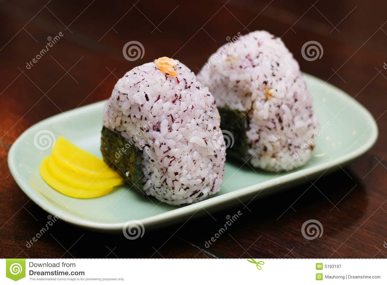 Two Japanese rice balls put on a plate.