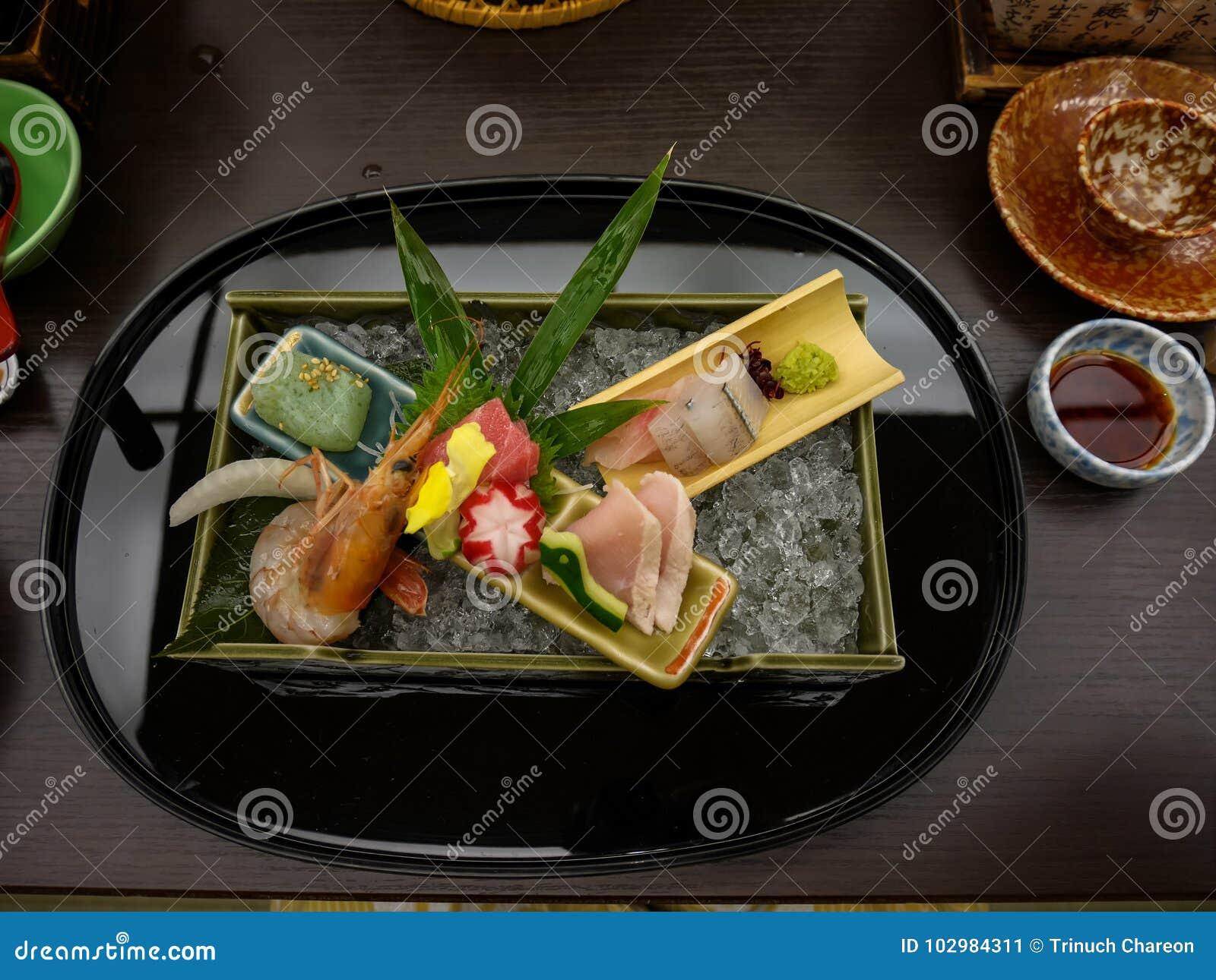 Japanese ryokan kaiseki dinner decorative sashimi set including Pacific blue fin tuna, shrimp, greater amberjack, halfbeak
