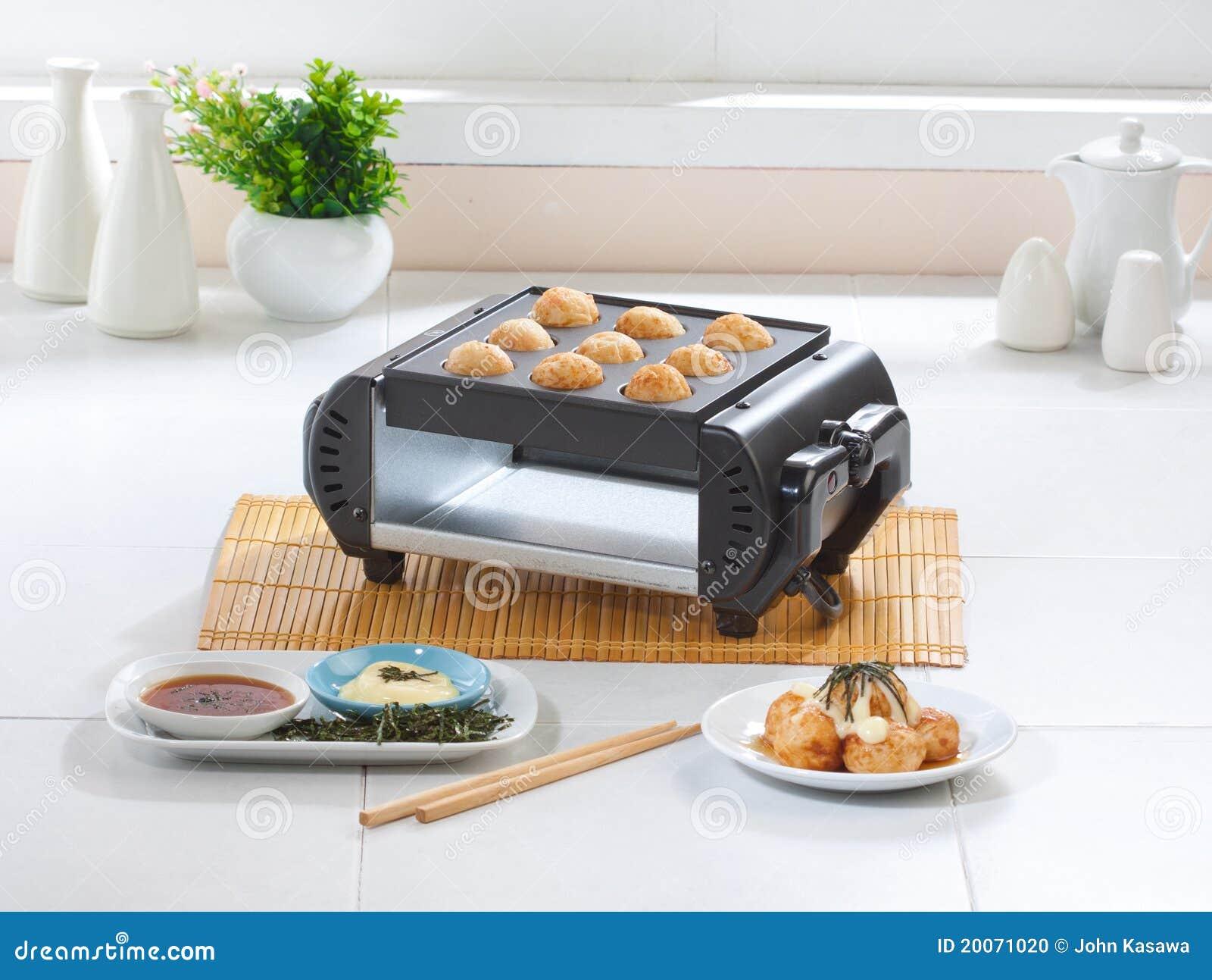 Takoyaki japanese food maker stove in the kitchen stock for Cuisine generator