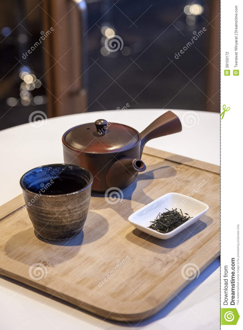 Japanese Tea Set With Tea Leaf On Wooden Tray Stock Photo