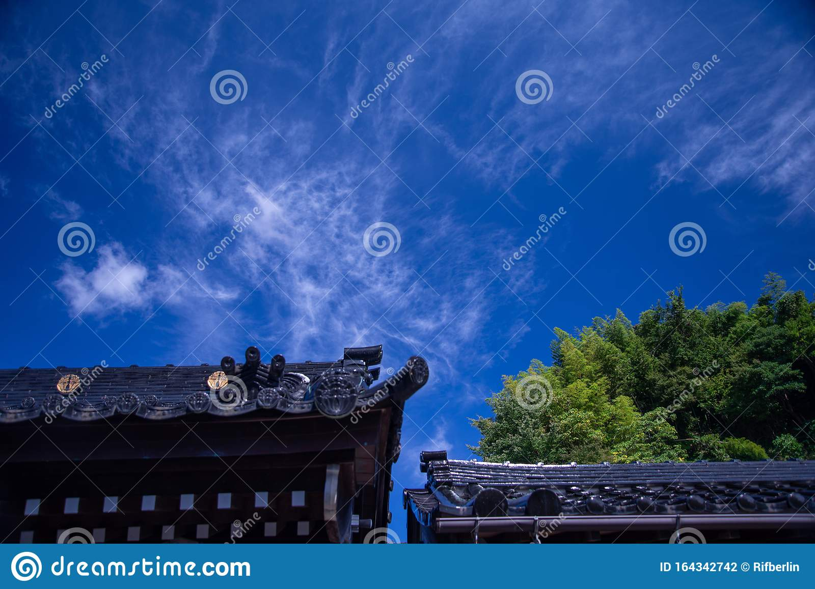 Japanese Temple Roof Architecture Agains A Blue Sky Stock Photo