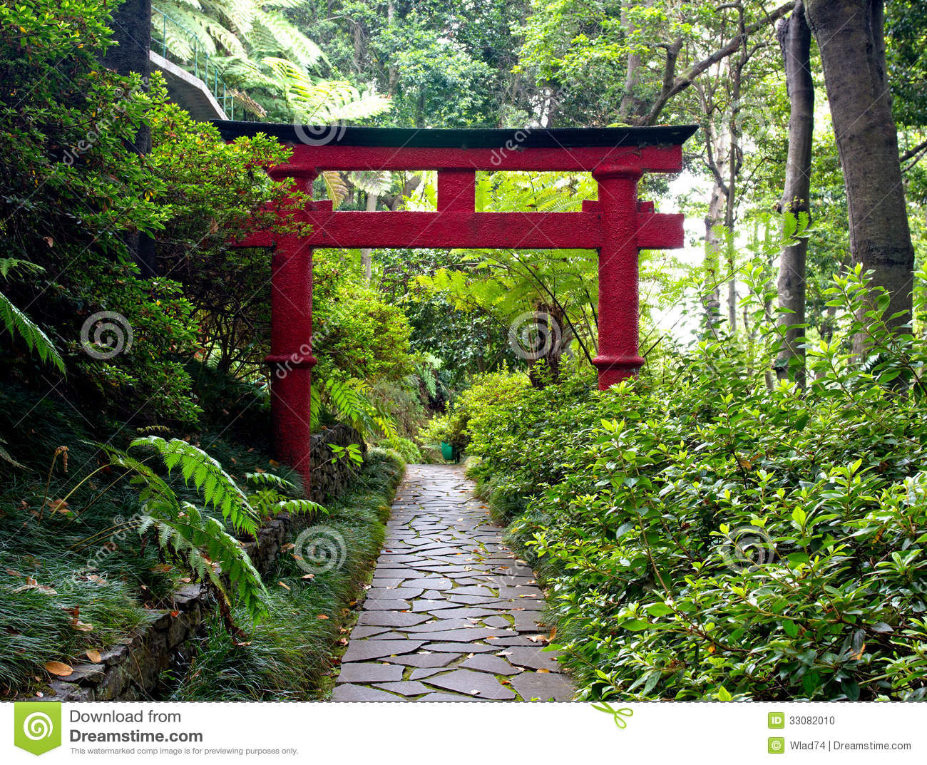 Japanese Torii Gate And The Stone Pathway In Zen Garden Stock
