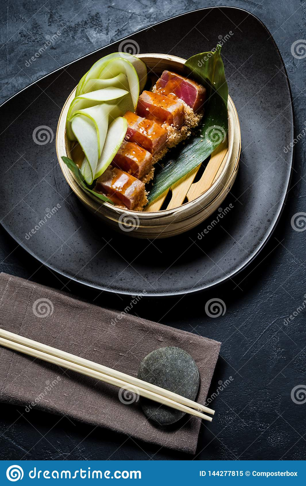 Japanese tuna sashimi, dark background, top view.