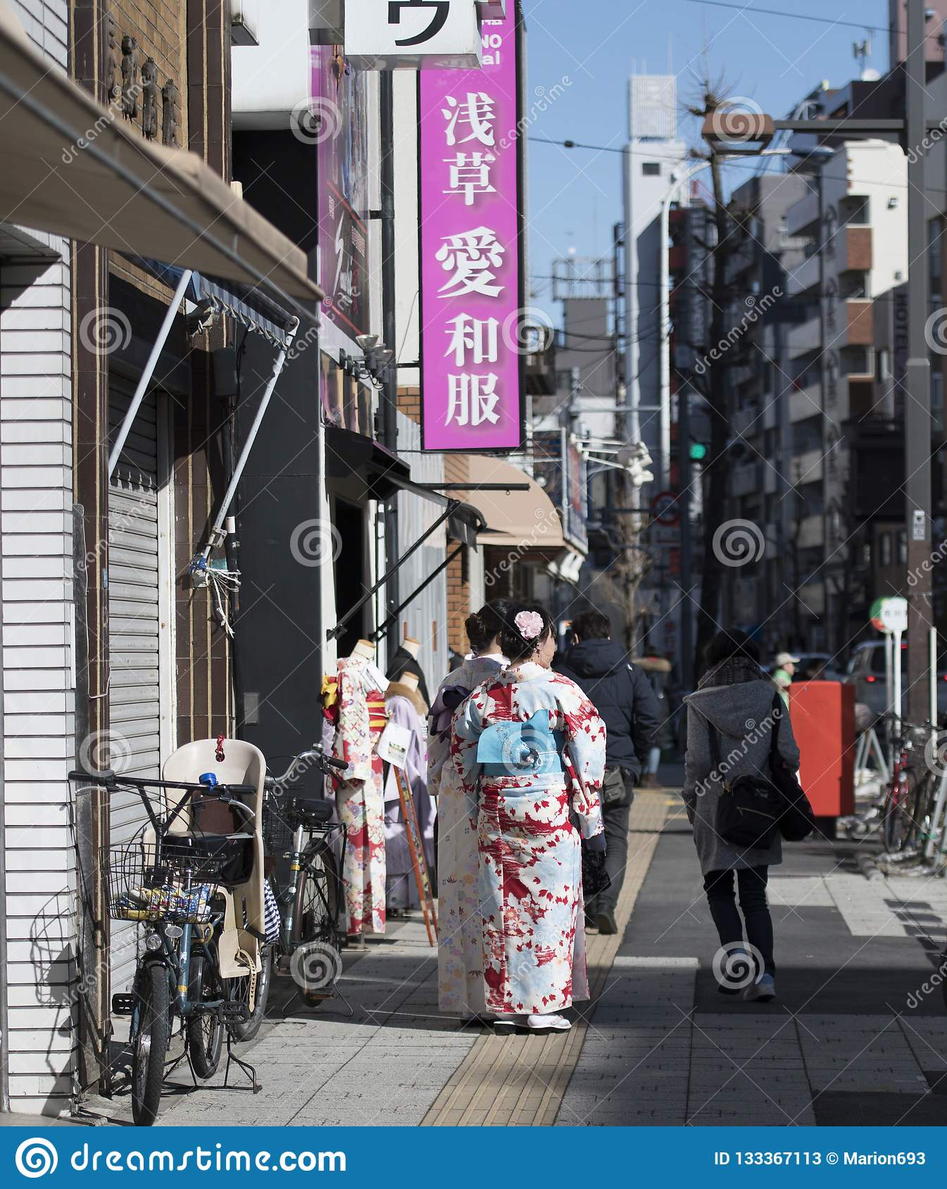 Japanese urban street scene with women dressed in Kimonos