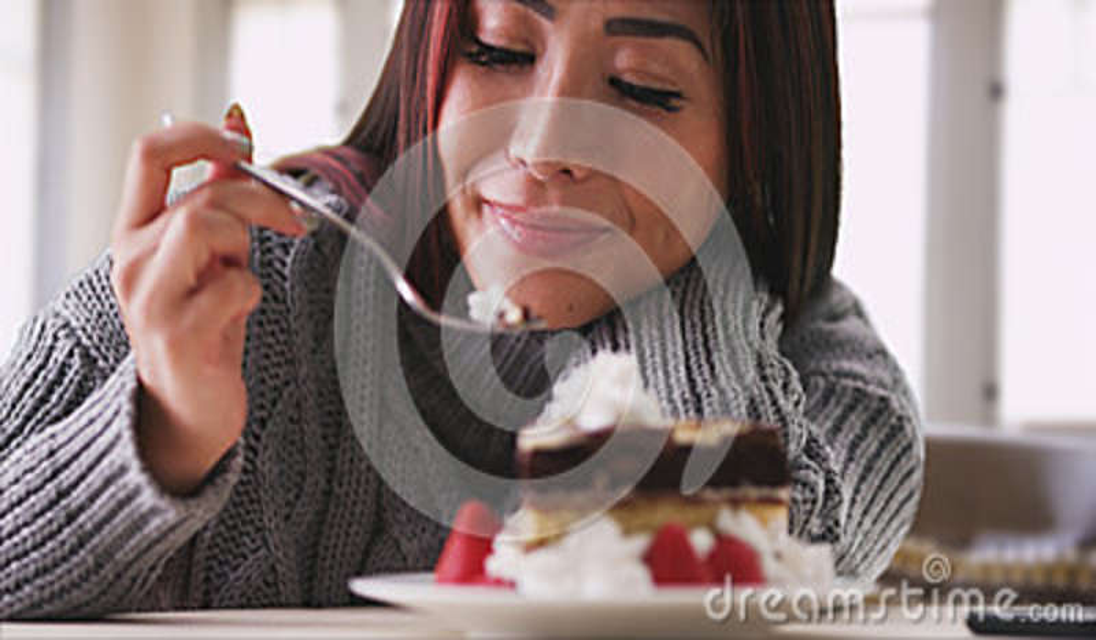 Japanese woman eating cake at home