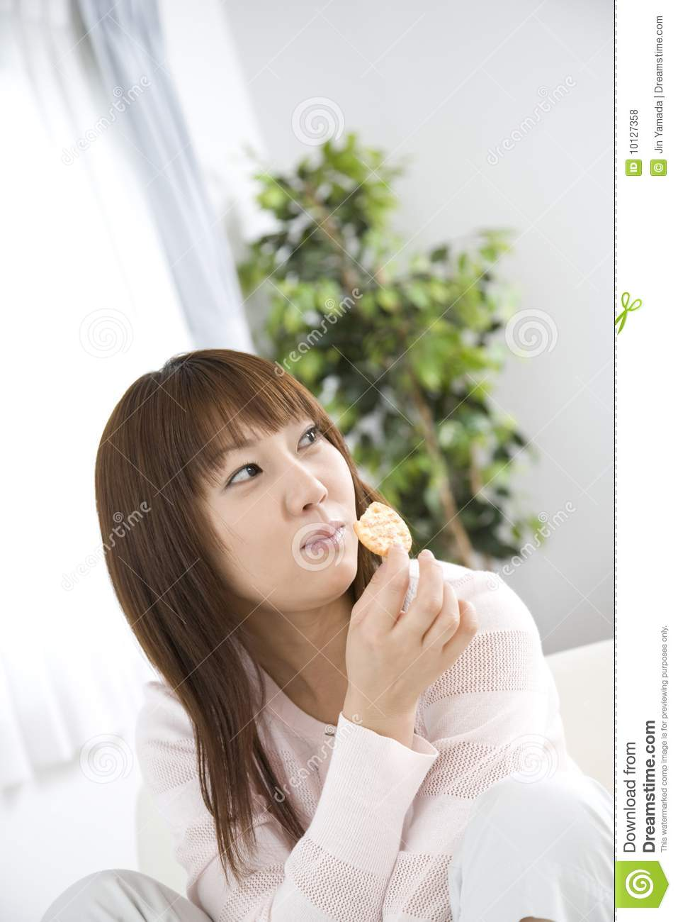 japanese woman eating a snack royalty free stock photos
