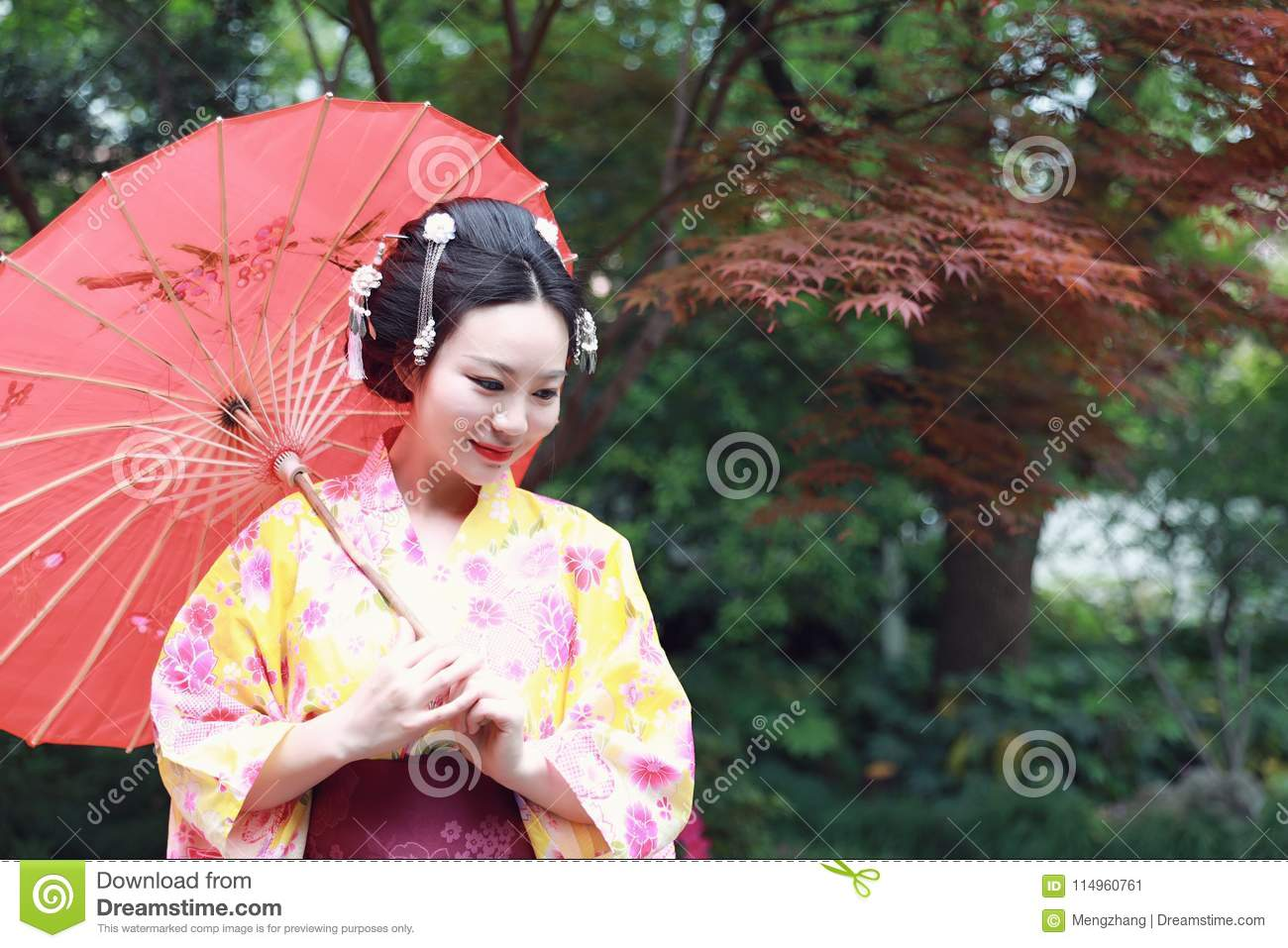 dea55e3293 Japanese woman with kimono Japanese bride smiling stand by bamboo in a  spring park Geisha with fan in the garden Asian style portrait of young  woman with ...