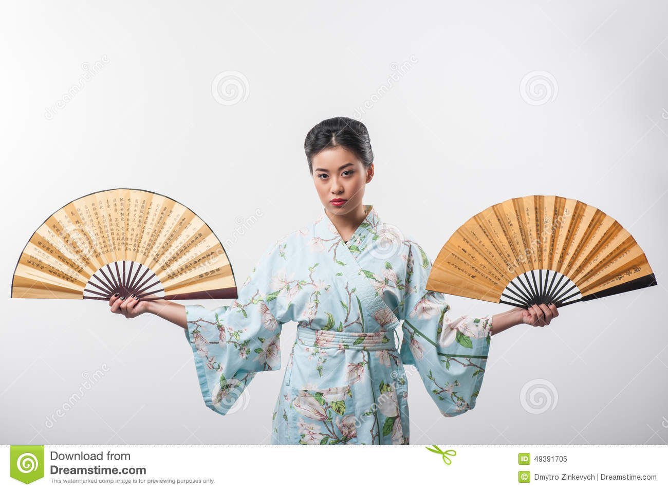 Japanese culture. Portrait of attractive Asian woman wearing Japanese  kimono and posing with two traditional hand fans while standing against  white ...