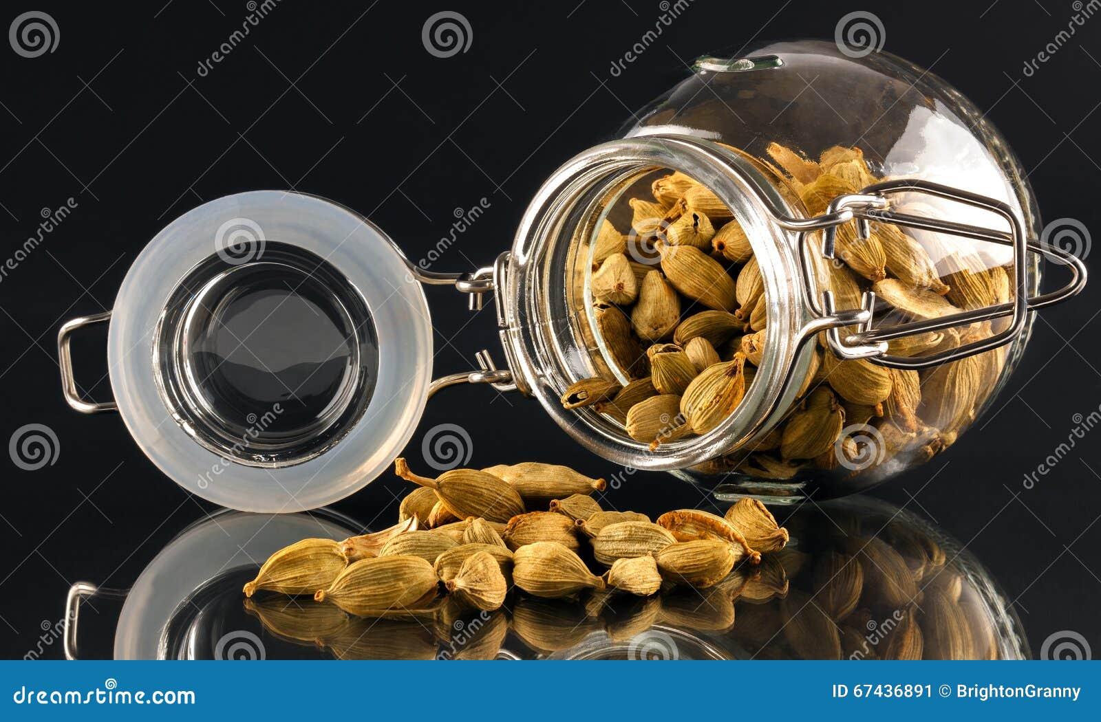 Jar of cardamom pods