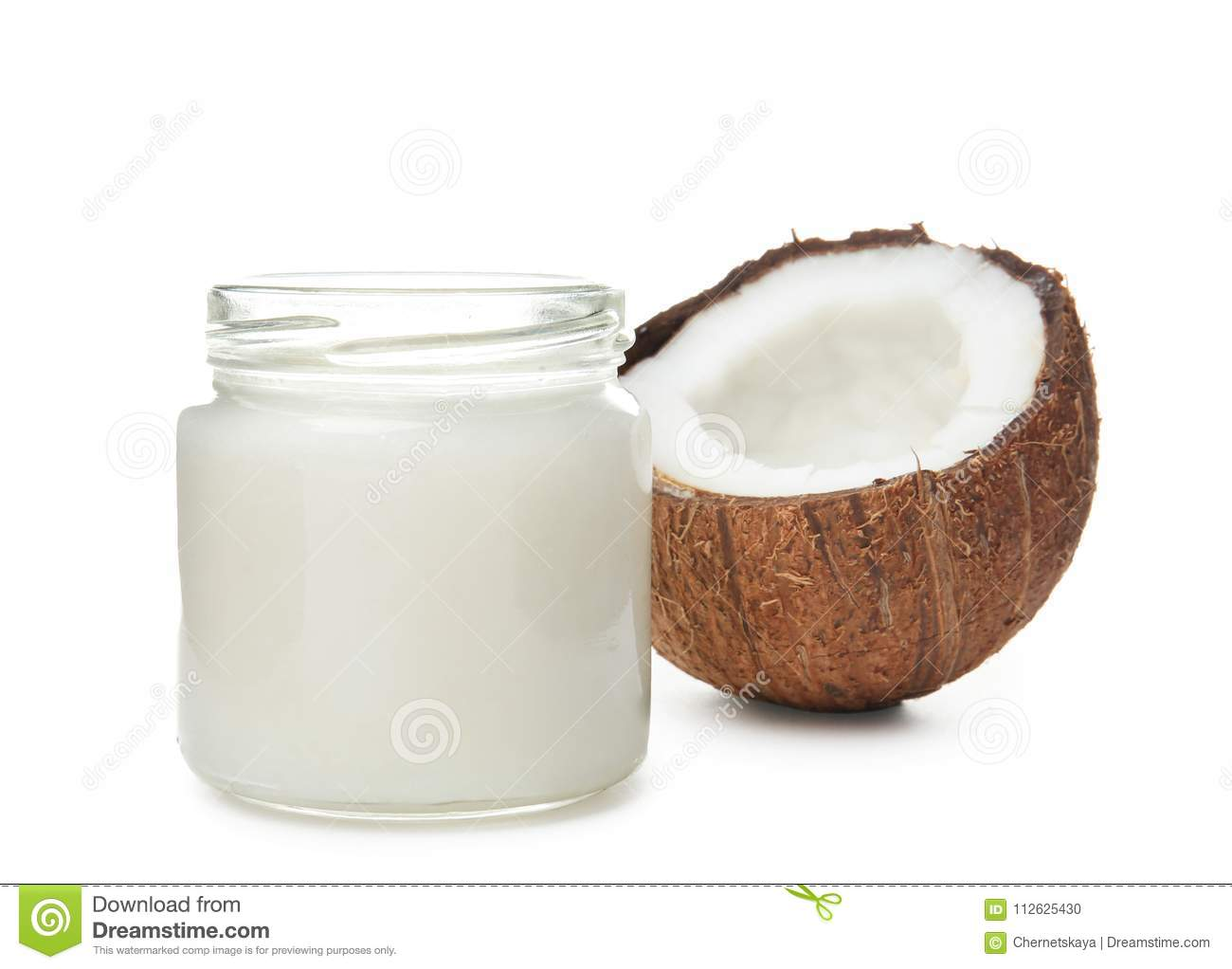 Jar with coconut oil and nut