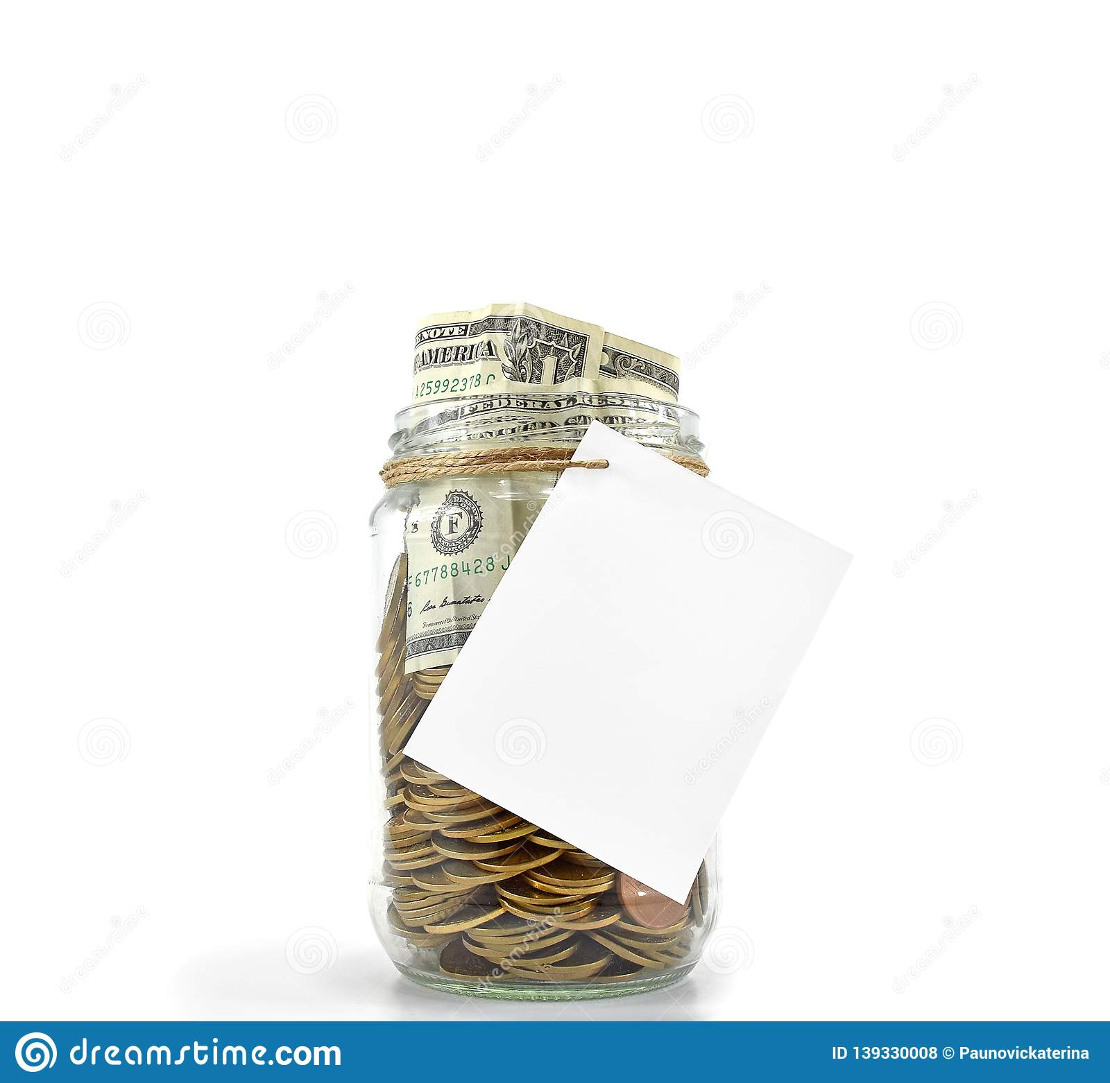 Jar full with coins and dollars with white paper ready for your message on white background Concept: Saving Money, Money Grow