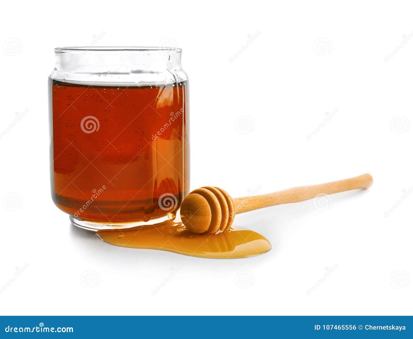 Jar of honey with dipper,