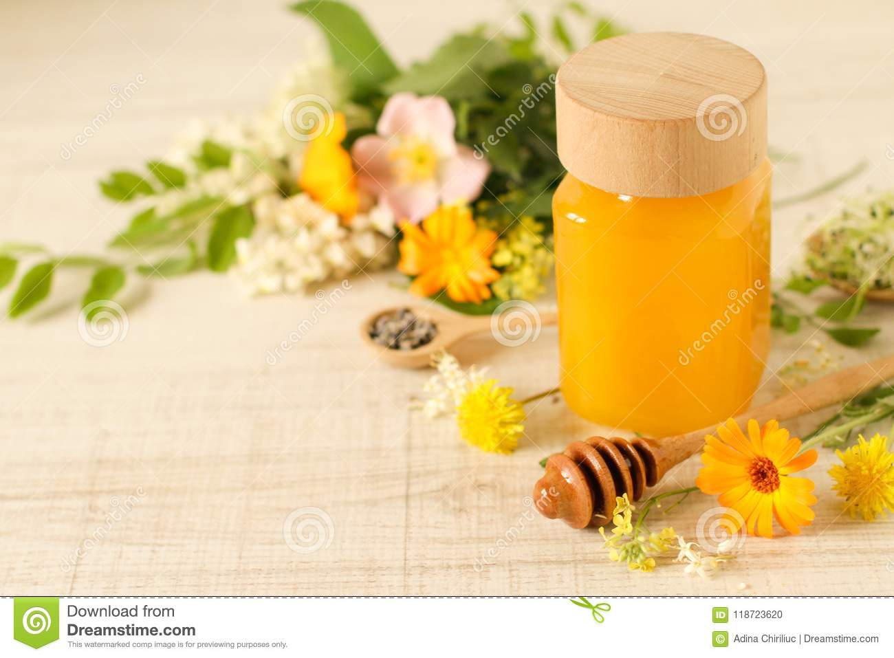 Jar Of Honey On A Table With Wild Flowers Stock Photo