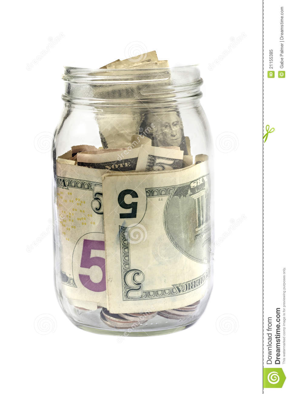 glass jar contains coin as well as paper currency in denominations ...