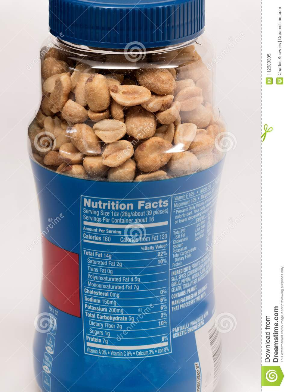 Jar of peanuts with the nutritional facts label showing