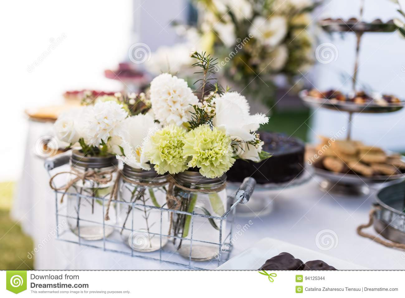 Jars with small white and green bouquets stock photo image of jars with small white and green bouquets mightylinksfo