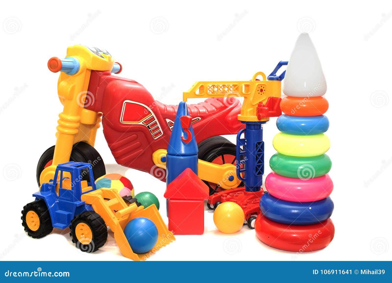 Jaskrawy barwić zabawki na białym tle odizolowywającym