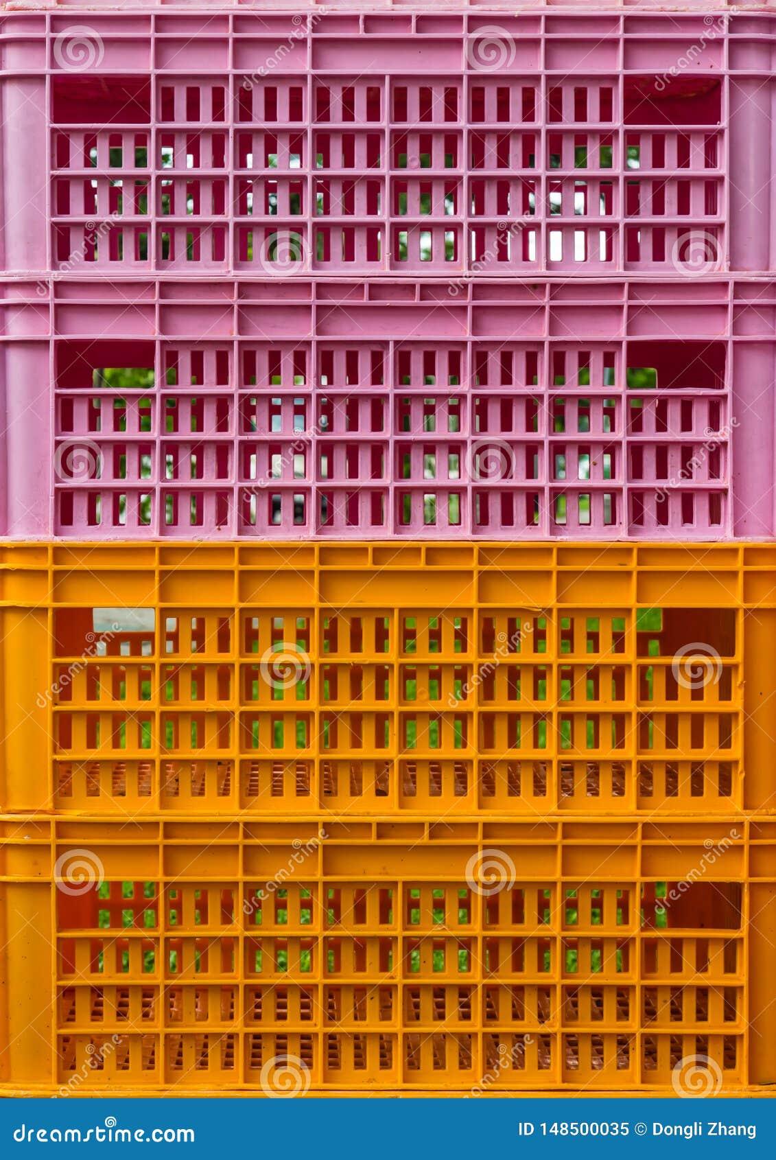 Jaskrawy kolorowy plastikowych pudełek tła widok