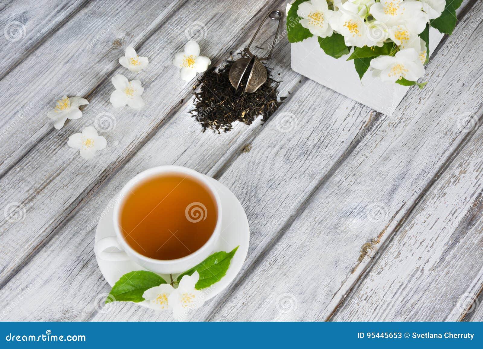 Jasmine dry green tea leaves with fresh jasmine flowers and white royalty free stock photo download jasmine dry green tea leaves with fresh jasmine flowers izmirmasajfo Gallery