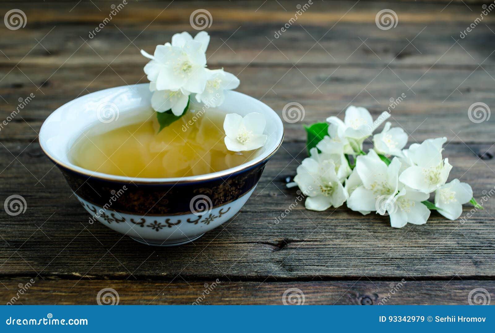 Jasmine Tea With Jasmine Flowers On Wooden Background Stock Image