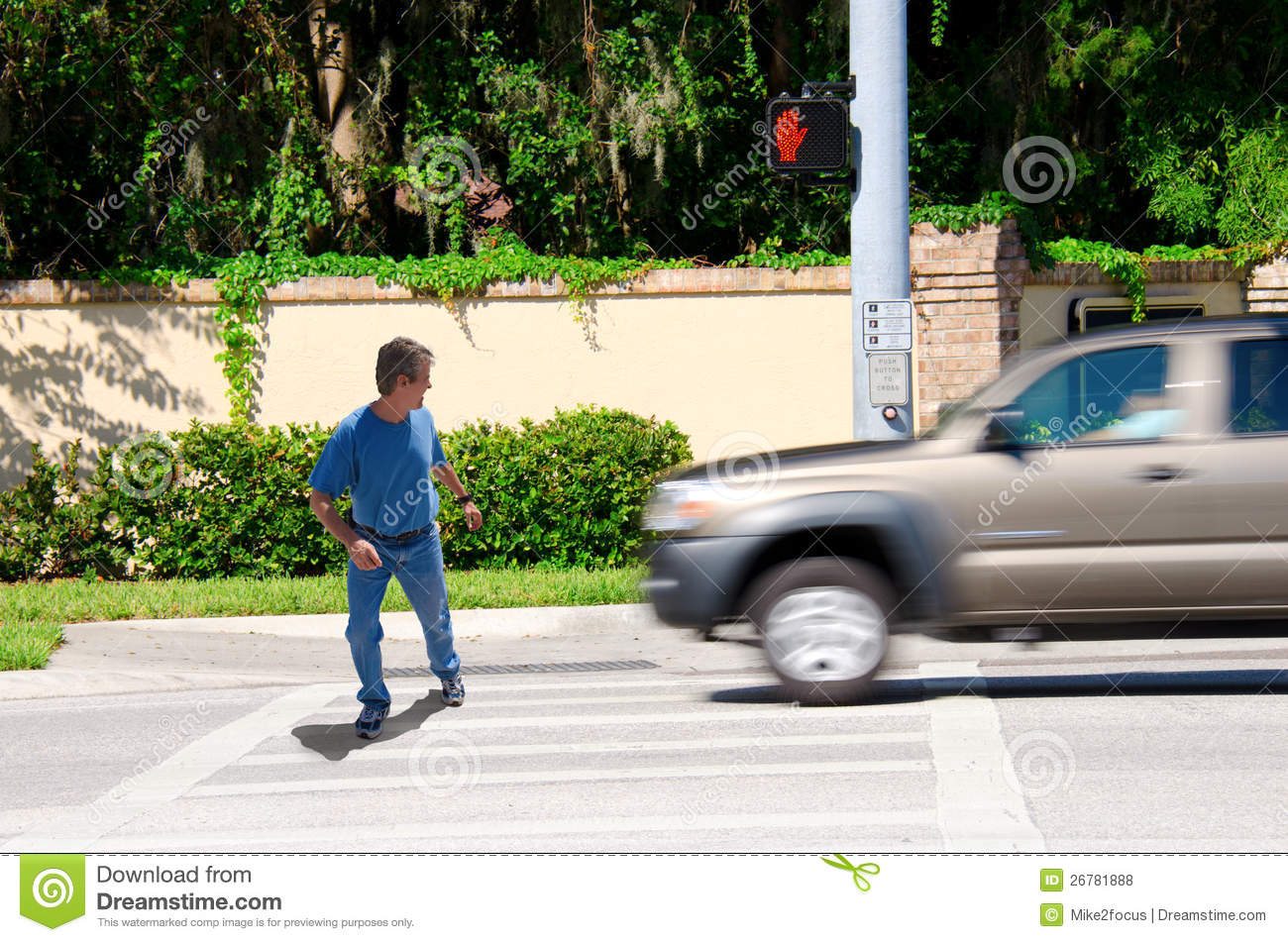 Jaywalking man about to be run over by truck royalty free stock photos