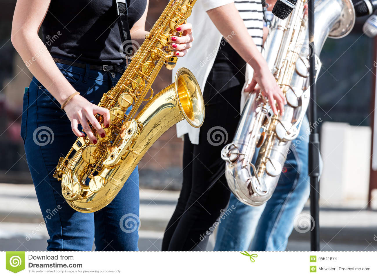 Jazz band of young musicians with saxophones performing during m