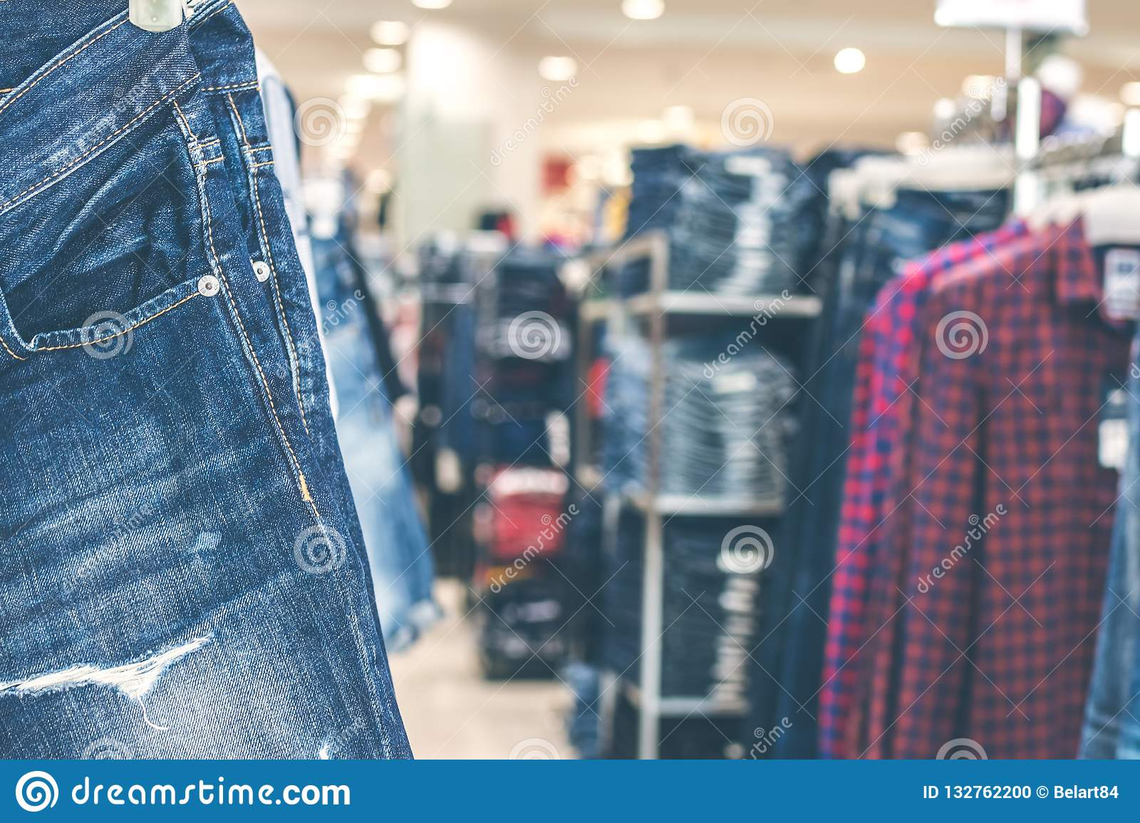 254aac31a Jeans Clothes Hanging In The Store. Stock Photo - Image of hanging ...