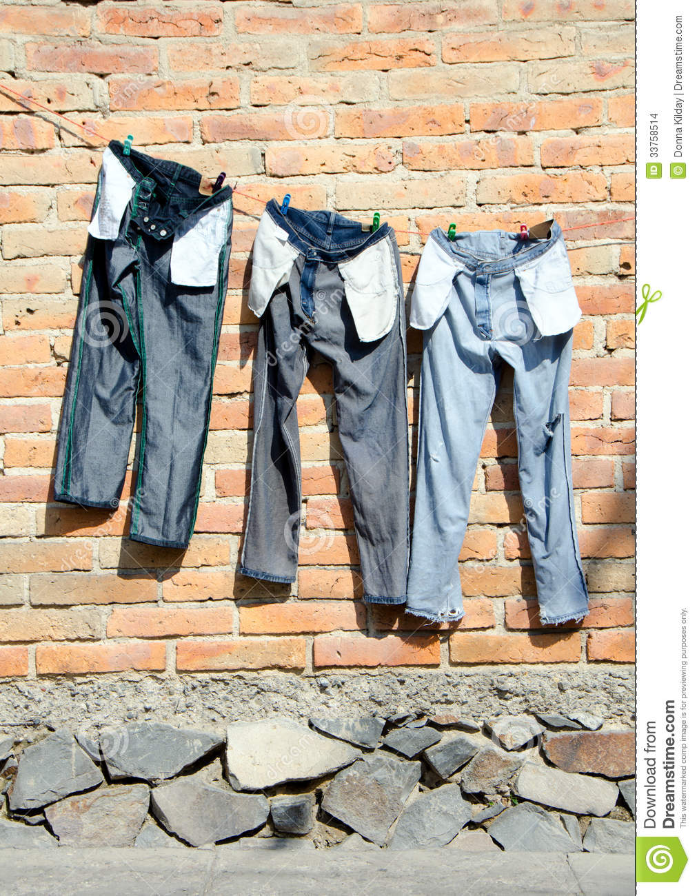 Clothes Drying On A Clothesline ~ Jeans on clothesline stock photo image of energy stone