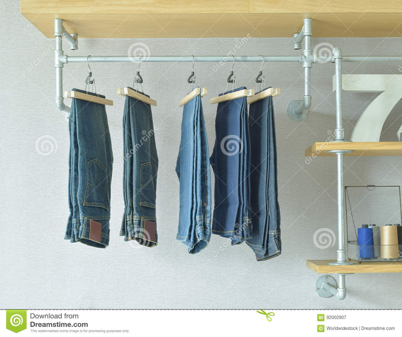 Astounding Jeans Hanging In Industrial Style Walk In Closet At Home Download Free Architecture Designs Rallybritishbridgeorg