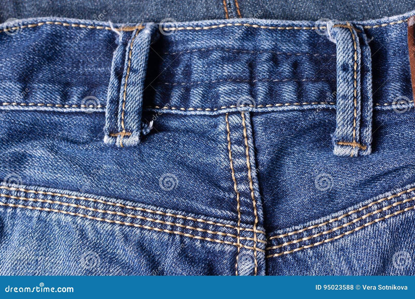 Jeans plan rapproché, coutures, boucles de ceinture Entrelacement du tissu  avec a 5641e6588f7
