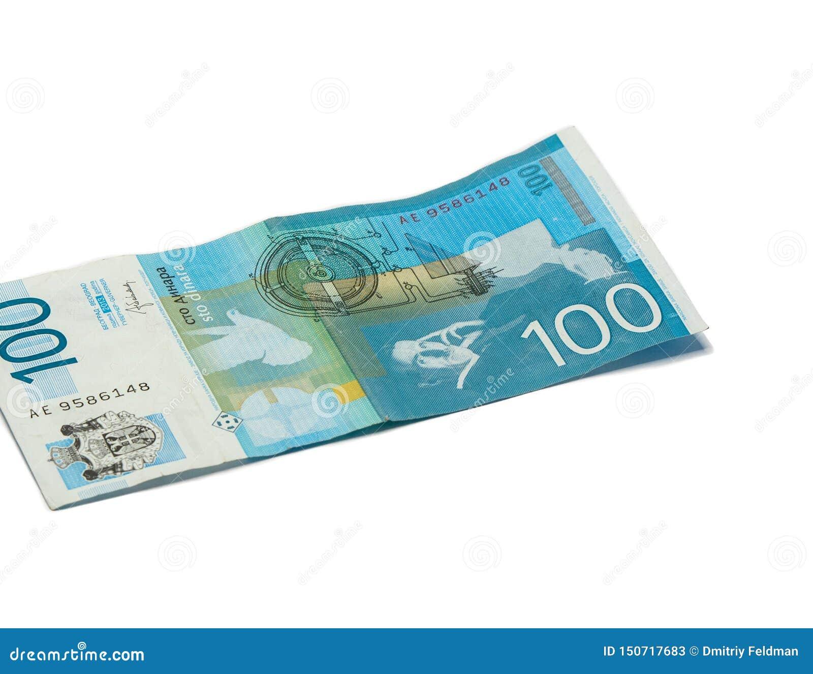 Jeden banknot warty 100 Serbskich dinarów z portretem naukowiec Nikola Tesla odizolowywająca na białym tle nowator i
