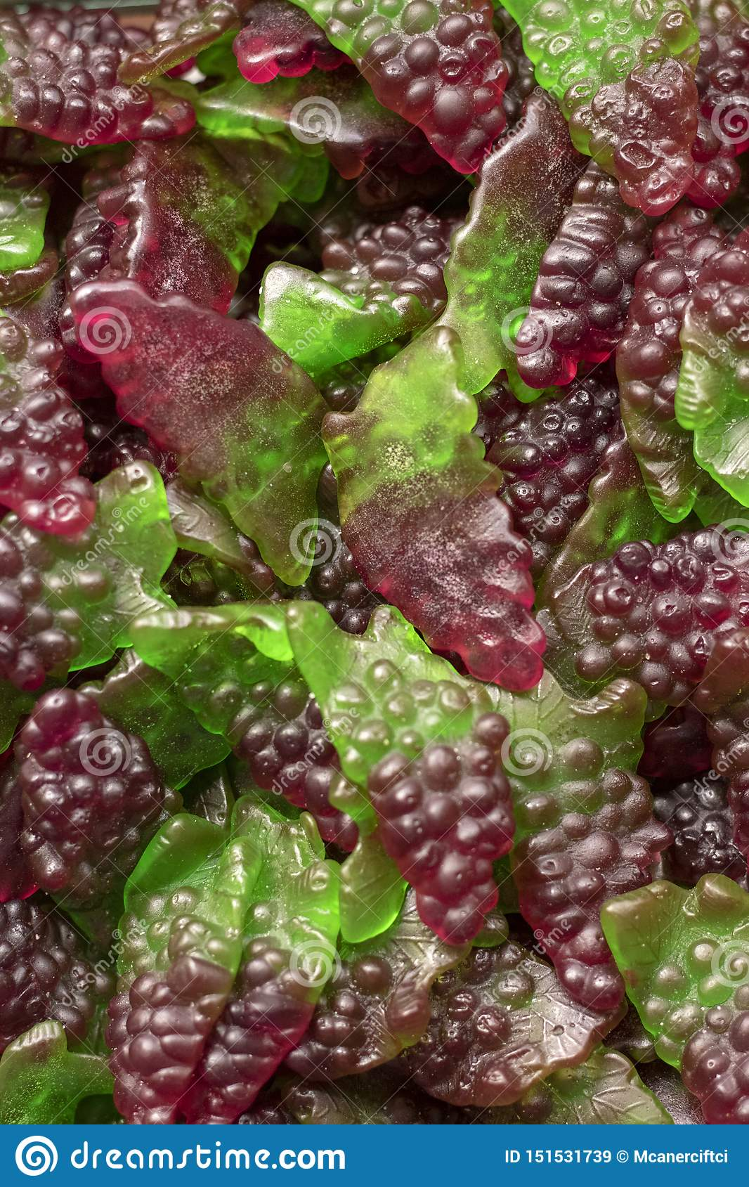 Jelly beans in green and red color. Close-up shot of front of store