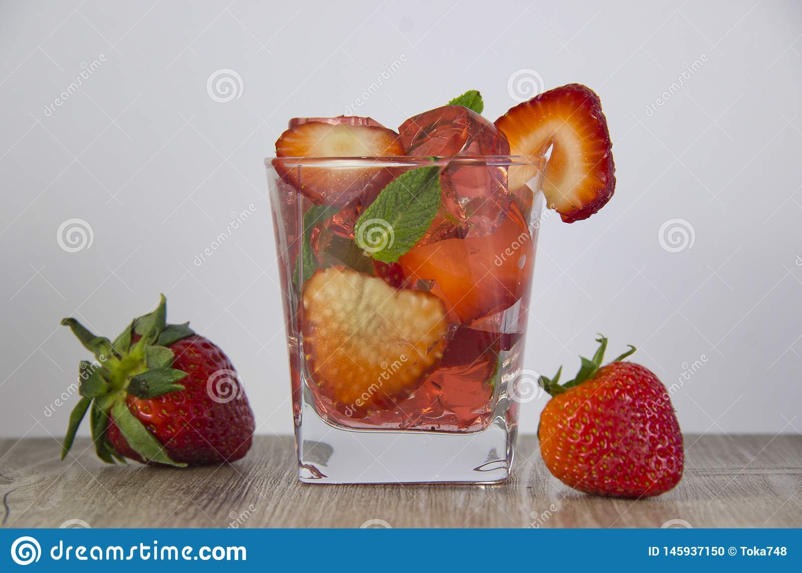 Jelly from strawberry juice with the addition of fresh berries.