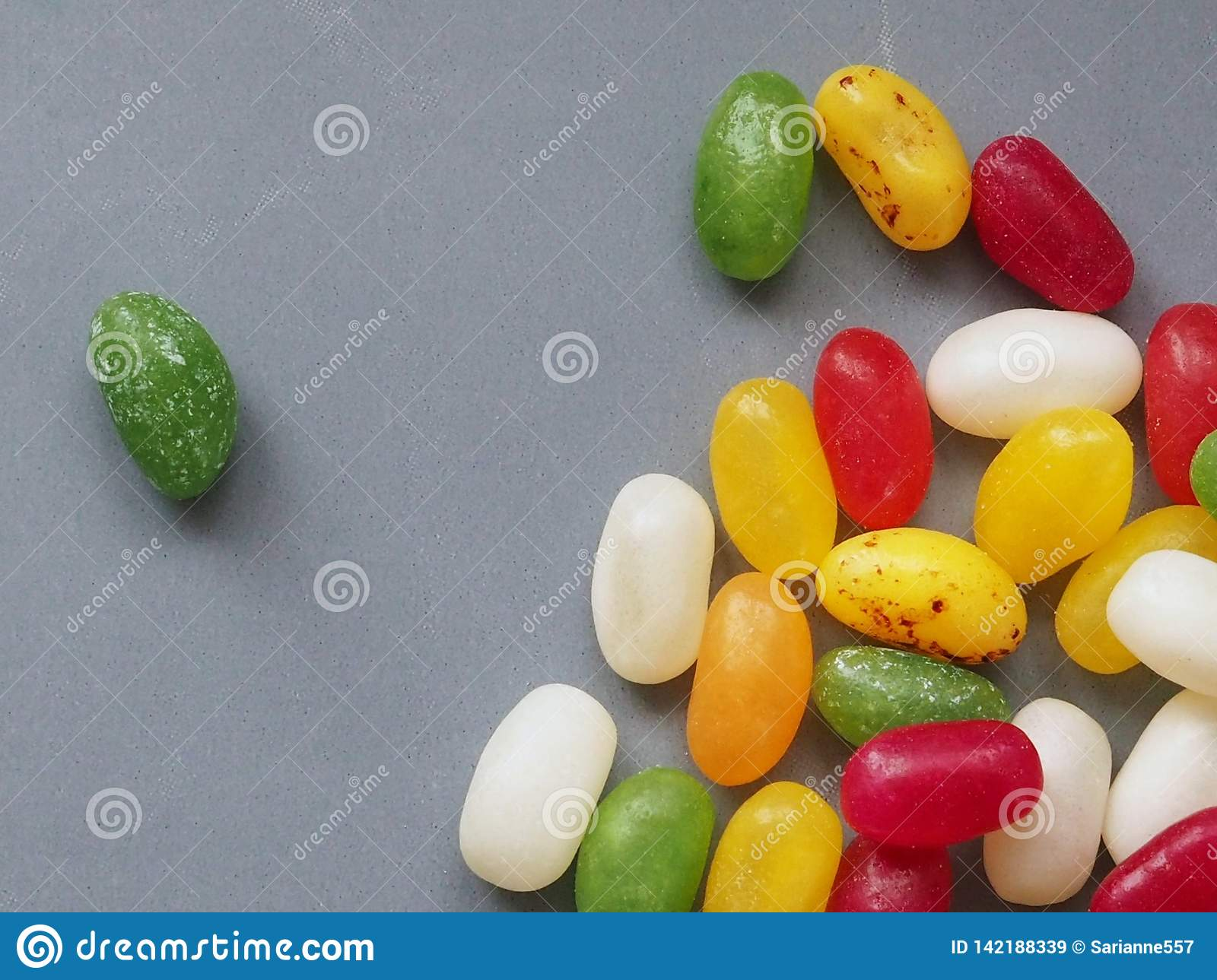 Jellybean sweets on grey background