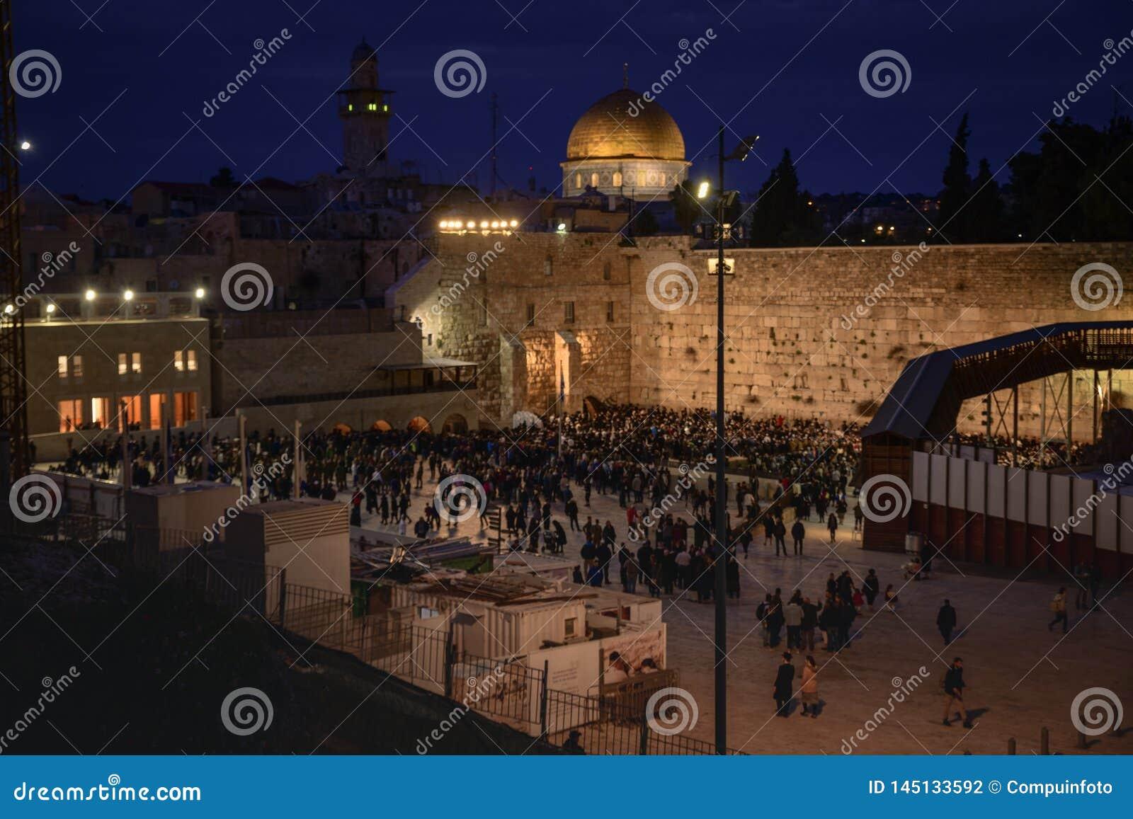People at the western wall at sabbath evening