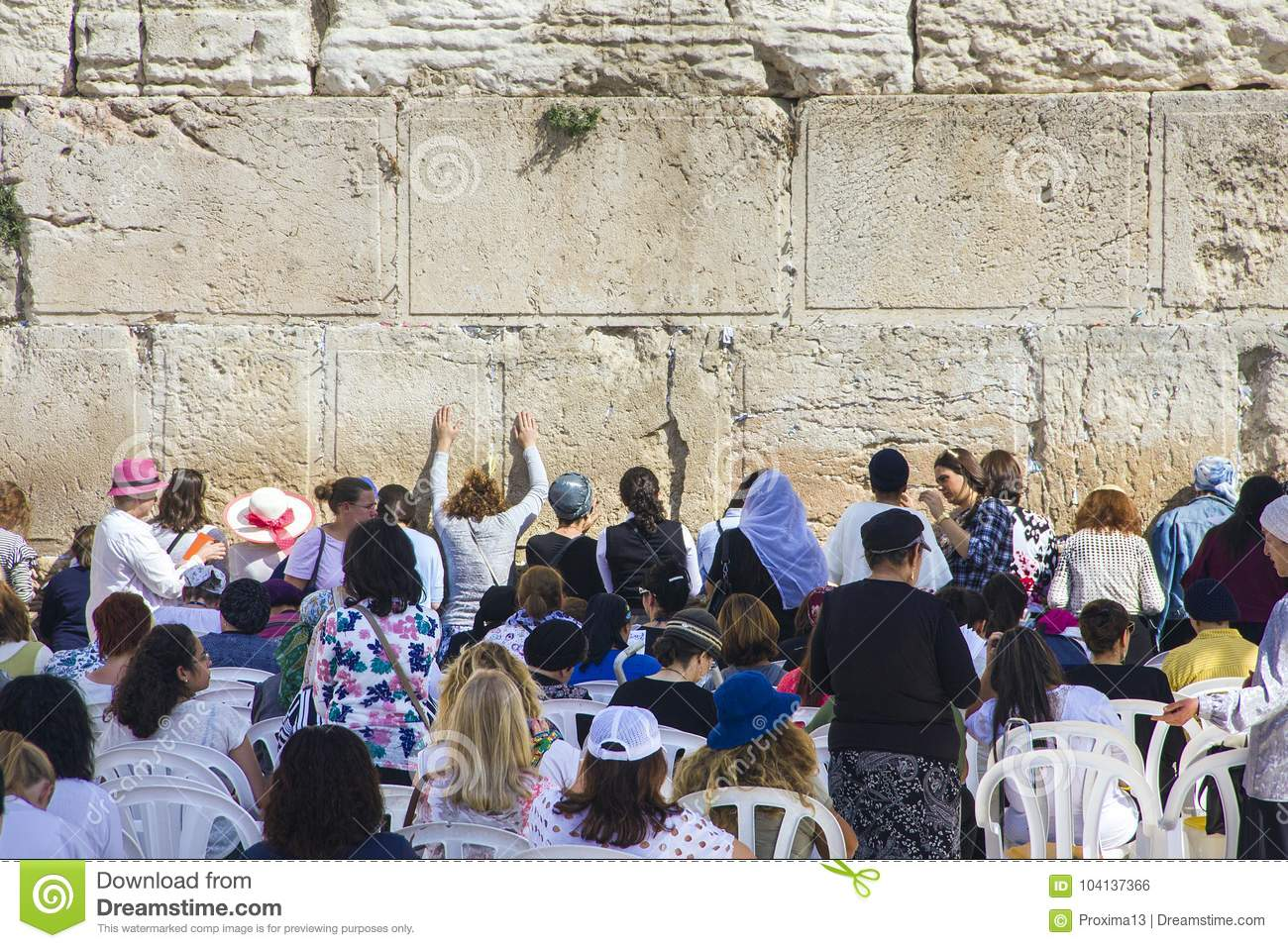 People pray a the Western Wall, Wailing Wall or Kotel the Place of Weeping is an ancient limestone