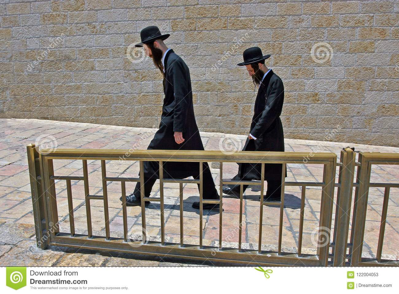 Jerusalem, Israel, 06.07.2007 two Jews with a beards in a black hats and a black robes are walking down the street
