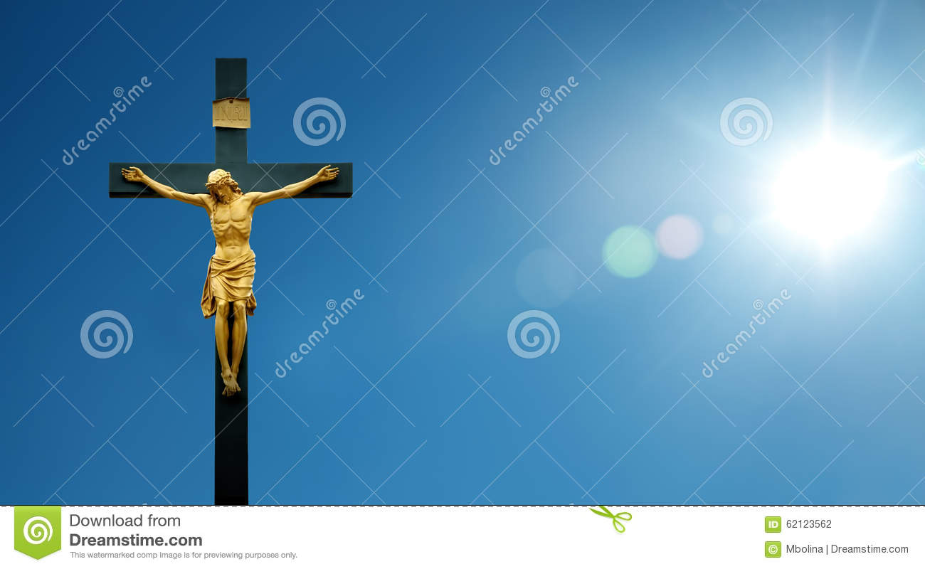 jesus christ on the cross over blue dramatic sky background stock