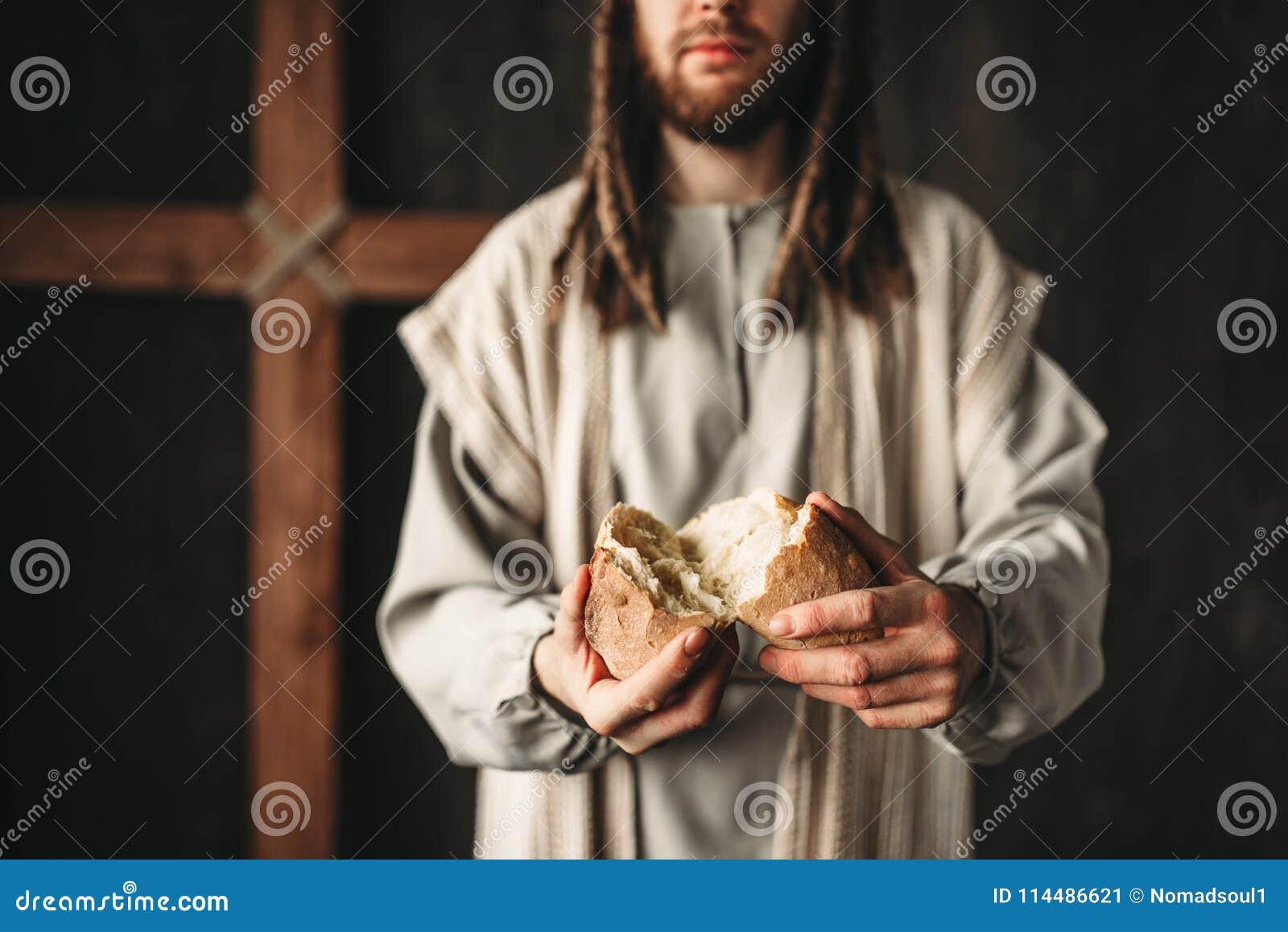 Jesus Christ dá o pão ao alimento fiel, sagrado