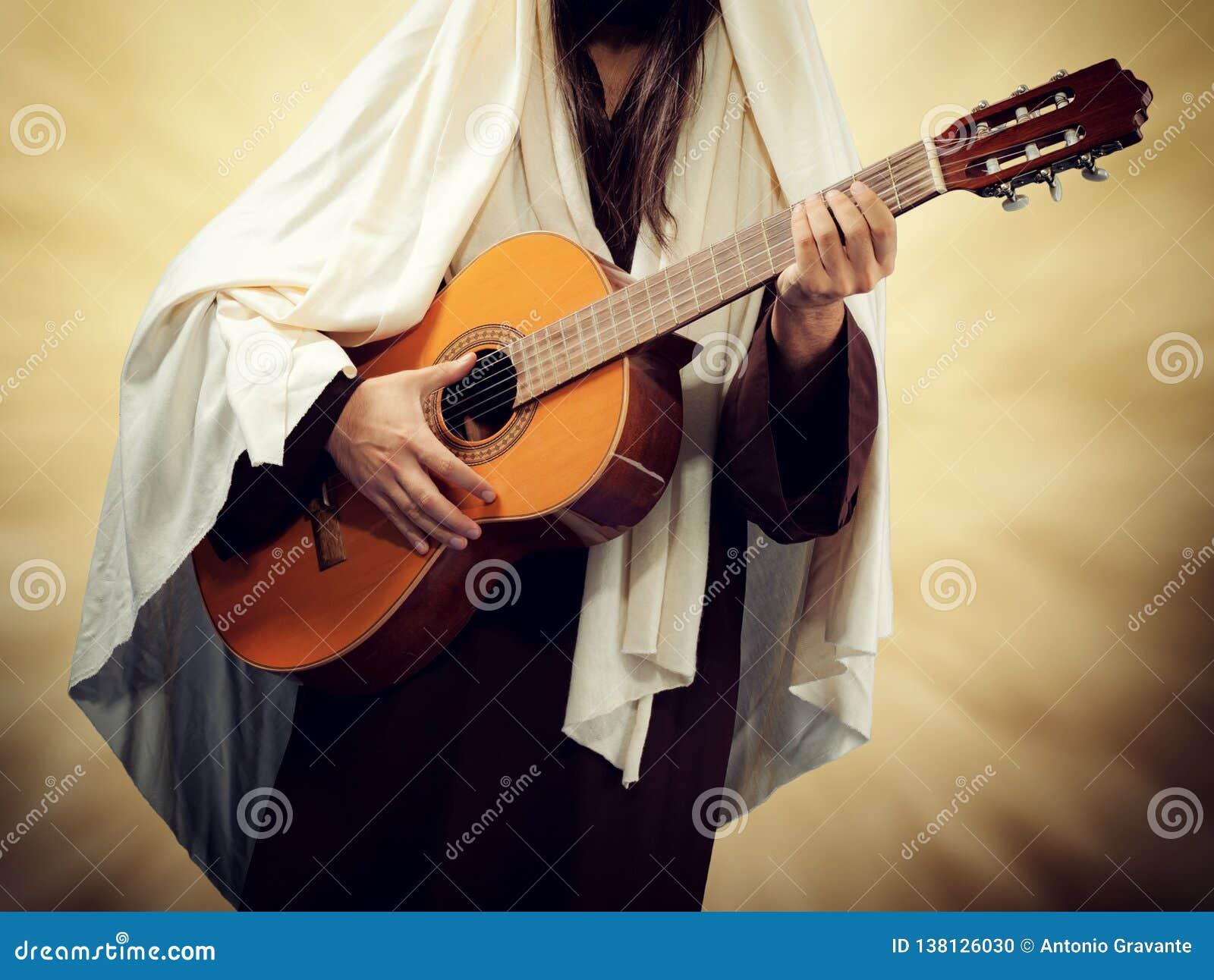 Jesus Christ toca la guitarra