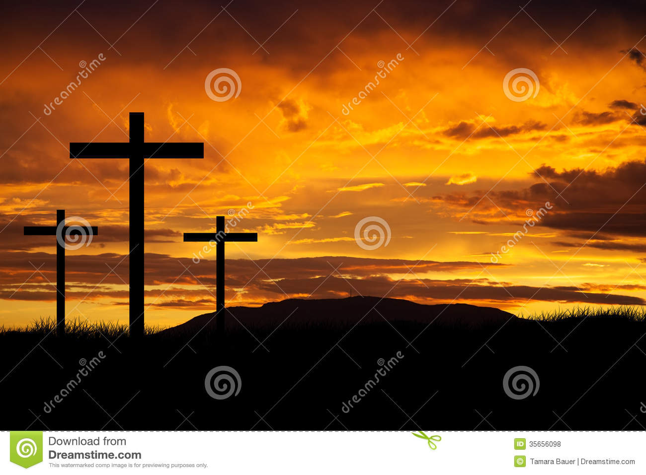 Three crosses at sunset representing the crucifixion of Jesus.