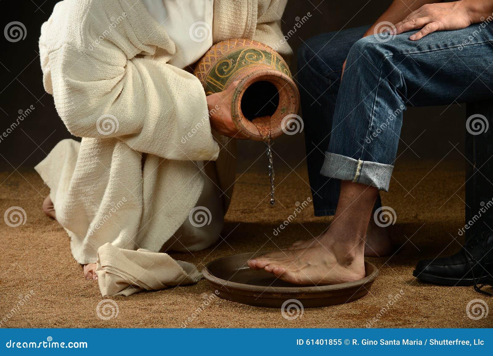 Jesus Washing Feet av den moderna mannen