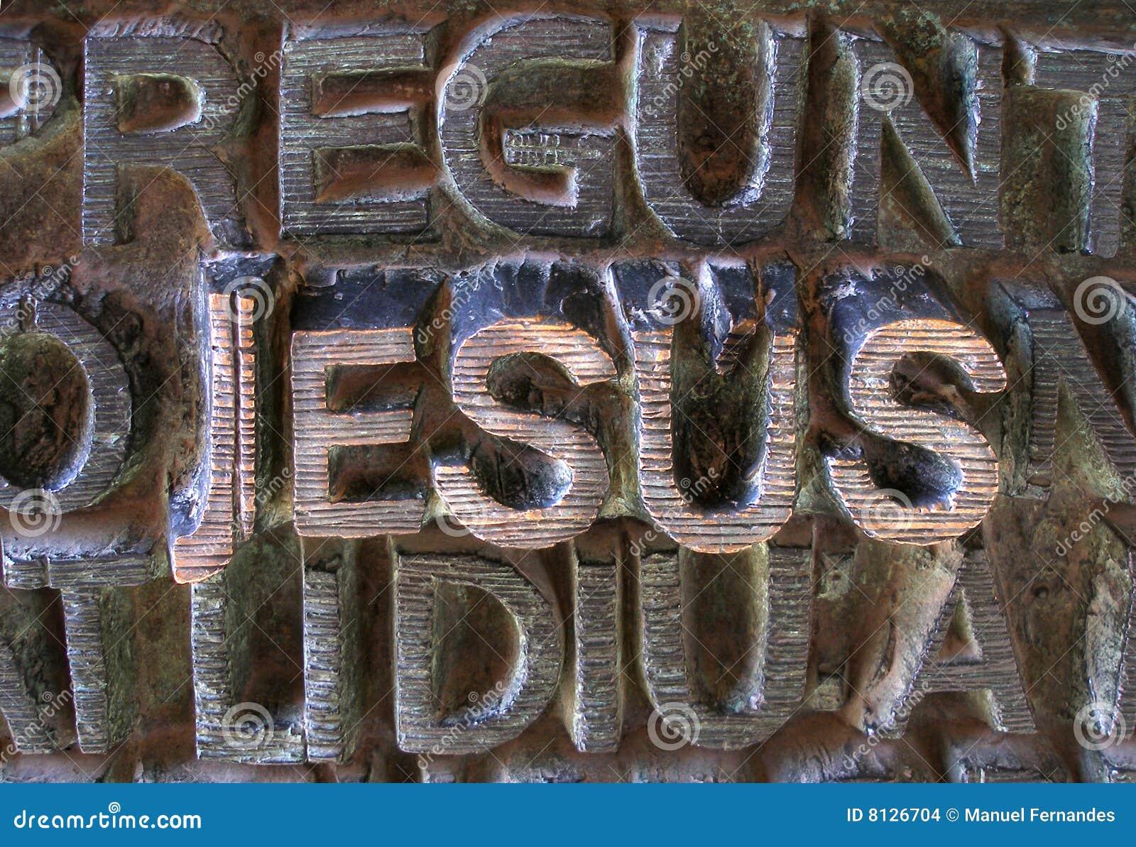 jesus written in metallic letters stock images