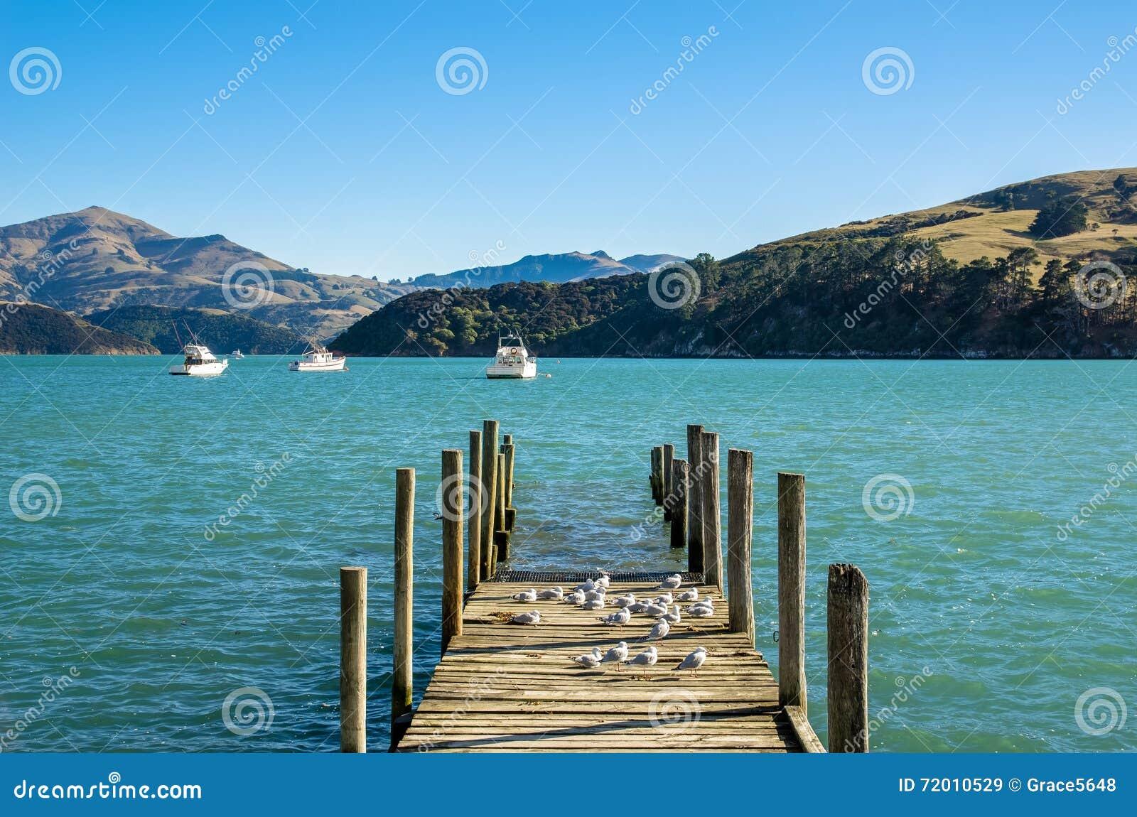 New Zealand Time Image: Jetty In Akaroa Stock Photo