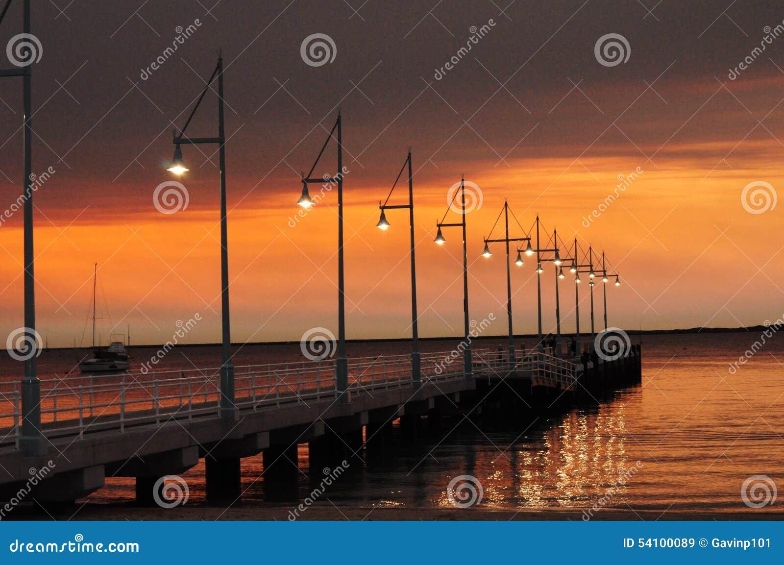 Pier with lights at sunset Perth Rockingham Western Australia