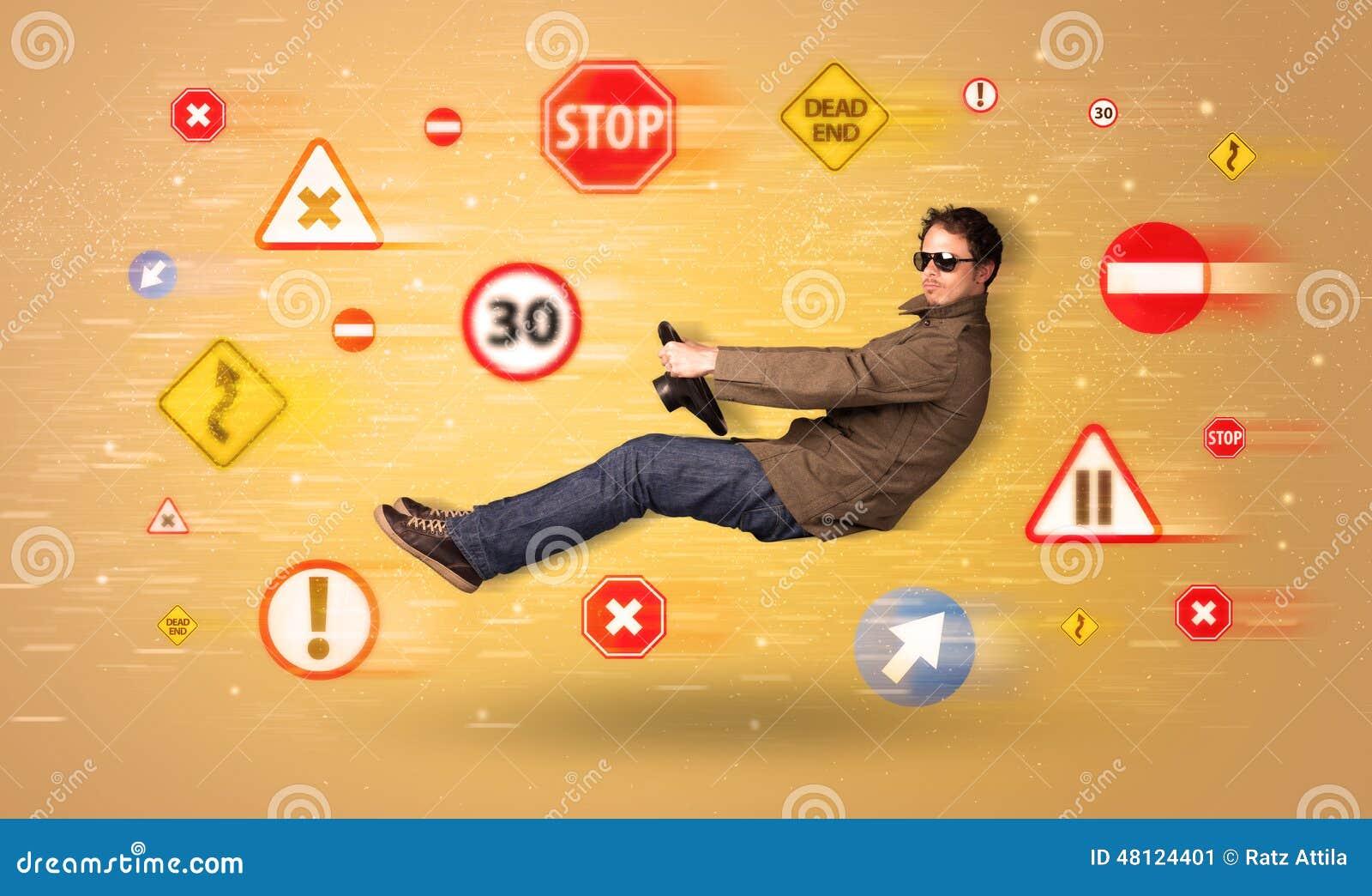 jeune conducteur avec des panneaux routiers autour de lui photo stock image 48124401. Black Bedroom Furniture Sets. Home Design Ideas