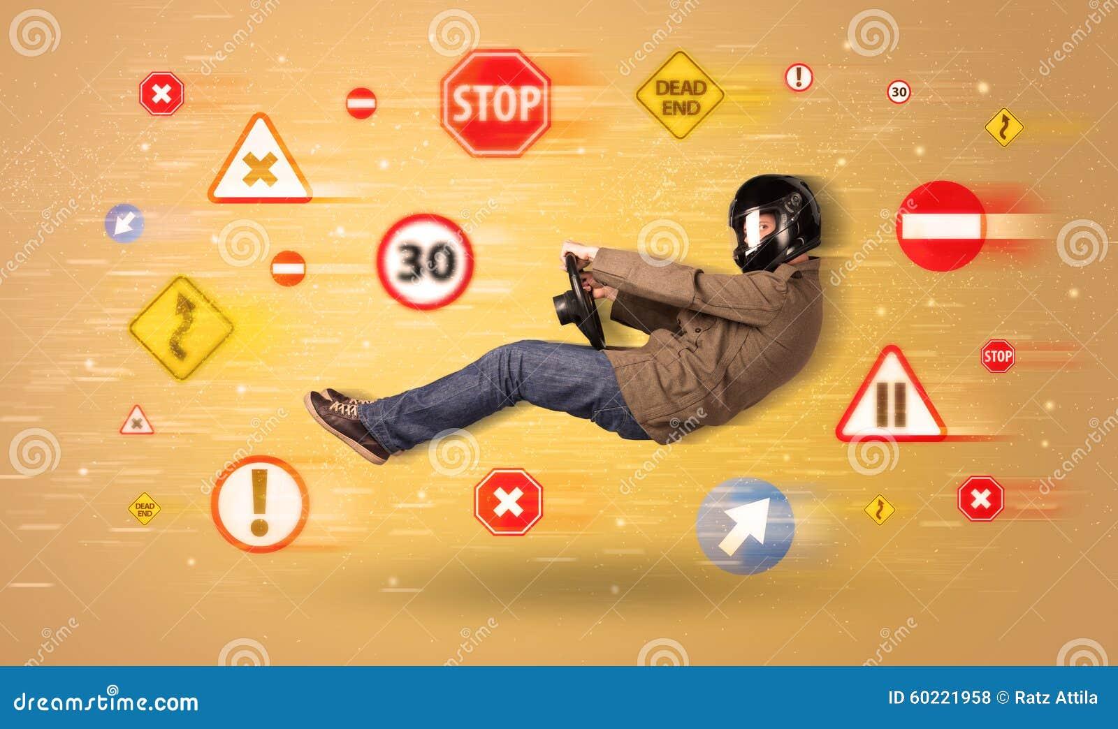 jeune conducteur avec des panneaux routiers autour de lui photo stock image 60221958. Black Bedroom Furniture Sets. Home Design Ideas