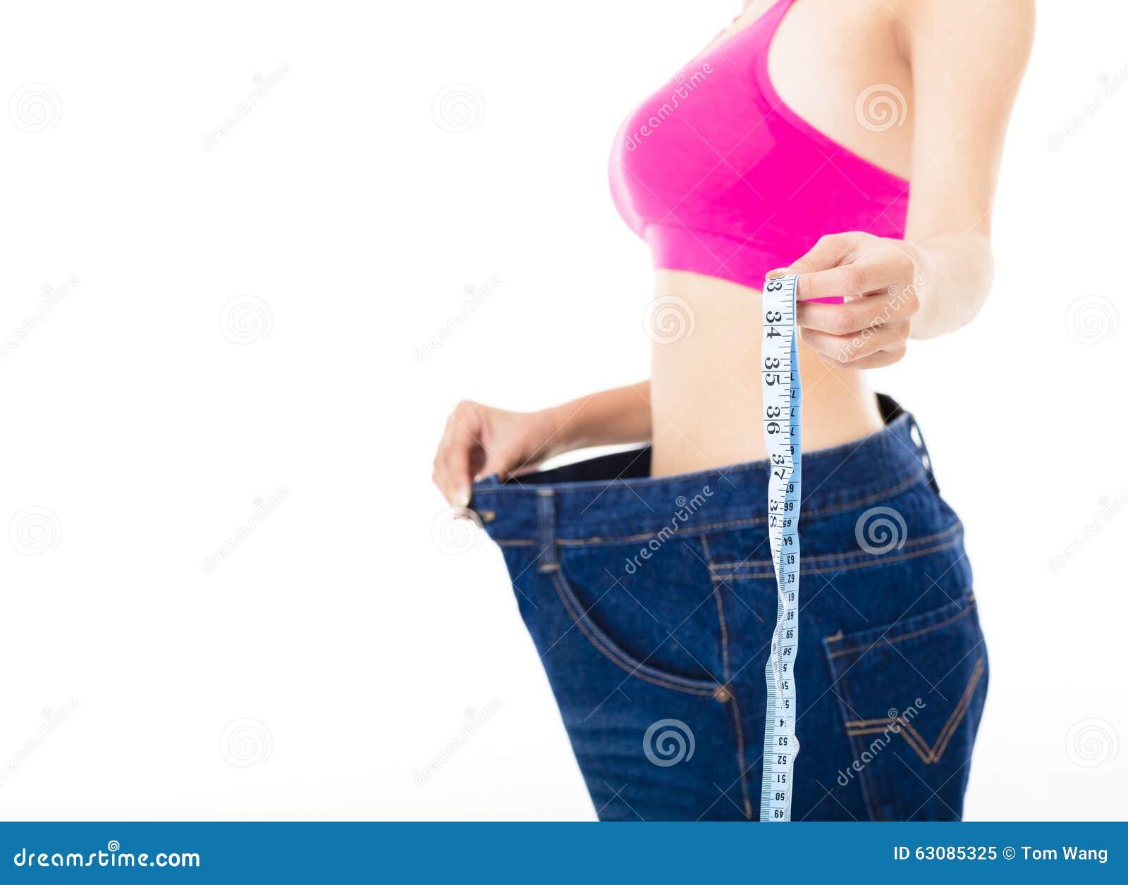 Download Jeune Femme Avec La Bande De Mesure Image stock - Image du santé, beau: 63085325